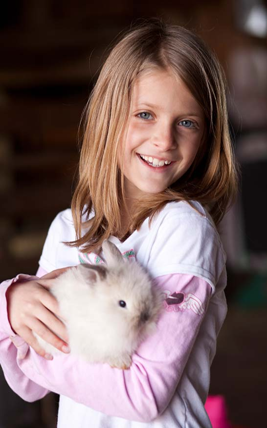 Dutch Village Petting Zoo Girl with Rabbit